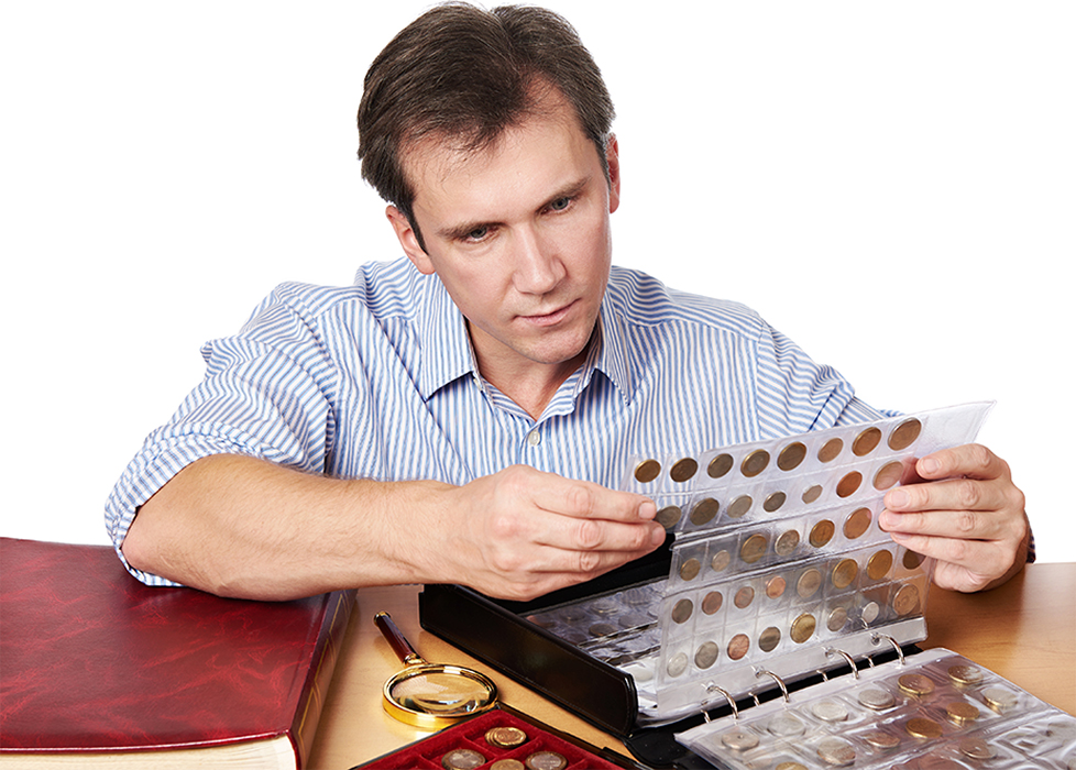 A collector taking stock of his collection.