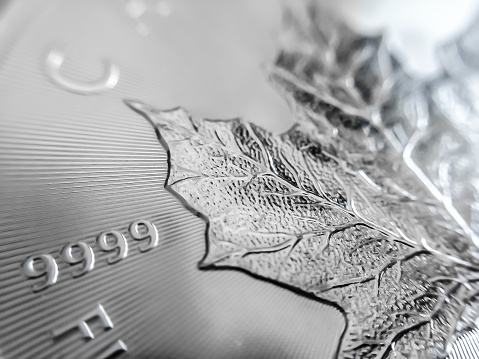 Up close of Silver Maple Leaf coin and radial lines